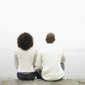 Couple sitting by lake --- Image by © Royalty-Free/Corbis