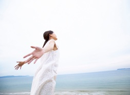 Woman by Ocean with Arms Outstretched --- Image by © Royalty-Free/Corbis